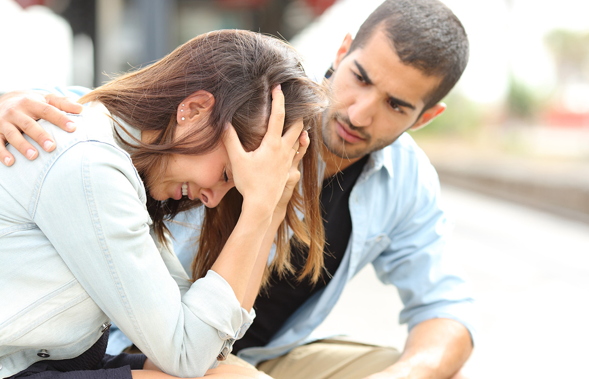 Man Consoling a Stressed Woman